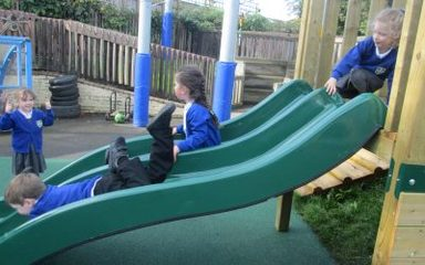 Reception enjoy playing on their new slide