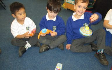 Reception class begin to find out about toys.